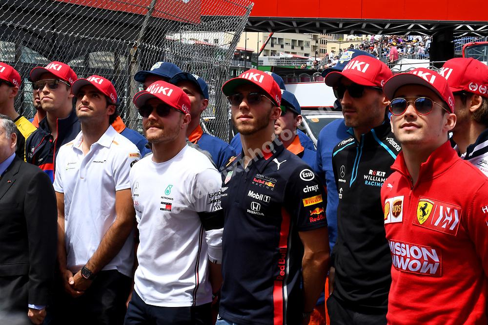 All drivers with red cap in memory of Niki Lauda before the 2019 Monaco Grand Prix. Photo: Grand Prix Photo