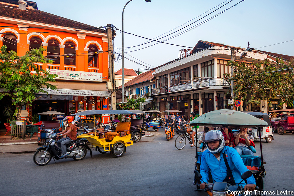 Busy Streets in Siem Reap Tourist area. Tuk tuk's and bicycles.