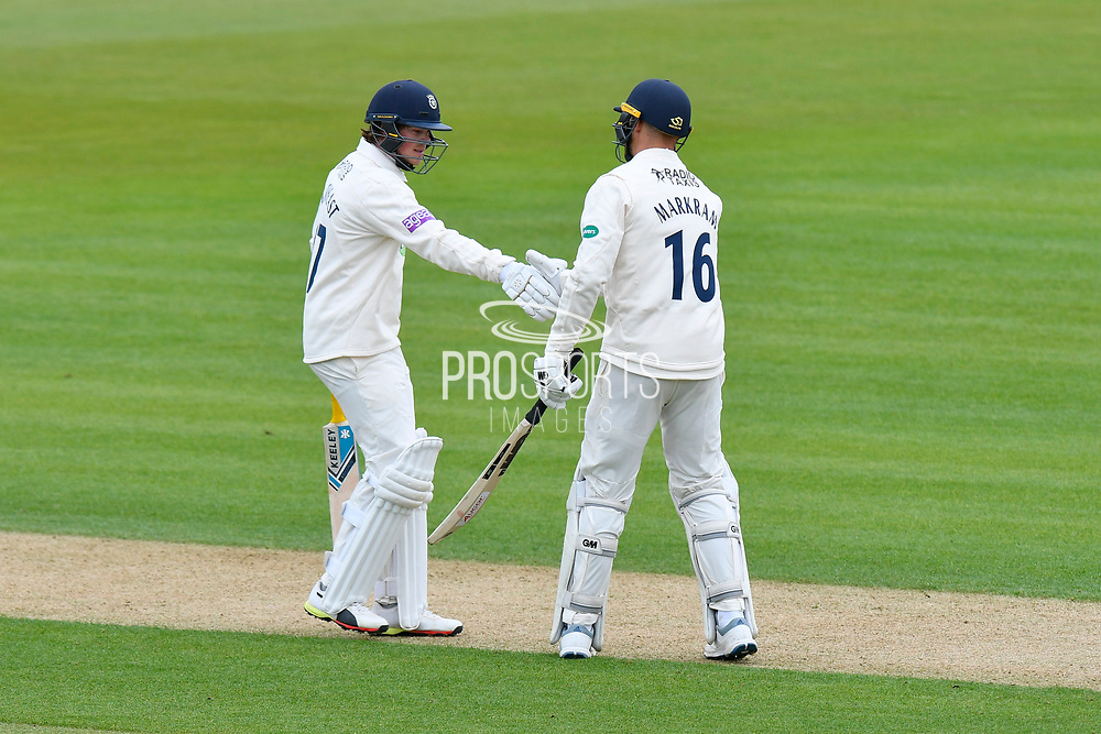 Sam Northeast of Hampshire shakes hands with Aiden Markram of Hampshire to mark the 50 partnership during the first day of the Specsavers County Champ Div 1 match between Hampshire County Cricket Club and Essex County Cricket Club at the Ageas Bowl, Southampton, United Kingdom on 5 April 2019.