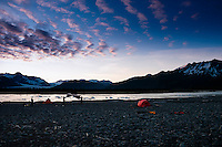 Campers set up camp across from Bear Lake and Bear Glacier at sunset in Kenai Fjords National Park, Alaska.