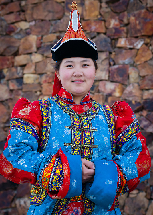 A young woman wears traditional Mongolian dress at a fashion show at Ongin Khiid Monastery, Mongolia. Photo © robertvansluis.com