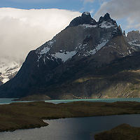 Clouds billow over the Horns of Paine and Lago Nordenskjold in Torres del Paine National Park in Patagonia, Chile.