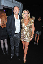 QUENTIN WILSON and his wife MICHAELA at a party to celebrate the launch of the new 2&8 club at Morton's Berkeley Square, London on 27th September 2012.