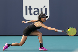 March 25, 2019 - Miami Gardens, FL, USA - Hsieh Su-wei, of Taiwan, returns a shot to Caroline Wozniacki, of Denmark, during their match at the Miami Open tennis tournament on Monday, March 25, 2019 at Hard Rock Stadium in Miami Gardens, Fla. (Credit Image: © Matias J. Ocner/Miami Herald/TNS via ZUMA Wire)