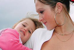 Young mother holding daughter,