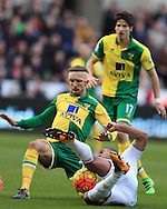 Wayne Routledge of Swansea city is tackled by Gary O'Neil of Norwich city. Barclays Premier league match, Swansea city v Norwich city at the Liberty Stadium in Swansea, South Wales  on Saturday 5th March 2016.<br /> pic by  Andrew Orchard, Andrew Orchard sports photography.