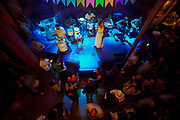 Rio Scenarium is possibly the most famous Samba Bar in Rio de Janeiro. Sitauted in the central and bohemian district of Lapa and spread over three floors, it plays host to some of the best Samba musicians in the World. Interior shot from above, crowd and band playing on stage.