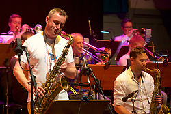Edinburgh International Film Festival, Rehearsal, world famous Edinburgh born jazz saxophonist Tommy Smith leads the Scottish National Jazz Orchestra in a musical tribute to ground-breaking Scottish playwright Tom McGrath. This special performance is complemented by readings of McGrath's poetry and extracts from his plays by another iconic Scottish talent, celebrated actor and performer Tam Dean Burn at the Queens Hall.<br /> Friday 23rd June 2017(c) Brian Anderson   Edinburgh Elite media