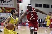 Maccabi Tel Aviv Basketball team (Yellow) Playing Hapoel Gilboa-Galil (Red) on October 16th 2011. Final result Maccabi 95 Hapoel 60 Yogev Ohayon