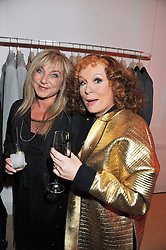Left to right,  HELEN LEDERER and JENNIFER SAUNDERS as her TV character Edina Monsoon at a party to celebrate the switching on of the Christmas Lights at the Stella McCartney store, Bruton Street, London on 29th November 2011.