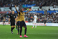 Joel Campbell of Arsenal celebrates with a 'dummy' in his mouth after he scores his teams 3rd goal. Barclays Premier league match, Swansea city v Arsenal  at the Liberty Stadium in Swansea, South Wales  on Saturday 31st October 2015.<br /> pic by  Andrew Orchard, Andrew Orchard sports photography.