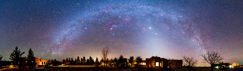 The winter Milky Way and Zodiacal Light in a 180° panorama taken at the Painted Pony Resort in southwestern New Mexico, March 11, 2013. The panorama is a composite of 4 segments, each a two layer stack, and each exposure 3 minutes at f/2.8 with the 14mm Samyang lens and Canon 5D MkII at ISO 1600, and each exposure tracked on the iOptron SkyTracker. The ground is from one exposure per segment. Jupiter is the bright object near the centre.