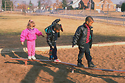 Preschoolers playing on school yard playground age 4.  St Paul  Minnesota USA