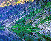 Rock Lake and rock cliffs in summer. Cabinet Mountains Wilderness Area in the Kootenai National Forest, northwest Montana,