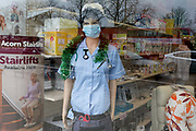 As the Coronovirus pandemic takes hold across the UK, with 53 cases now reported by health authorities, the window of a medical equipment business in south London, a surgical mask is worn by a nurses mannequin, on 4th March 2020, in London, England.