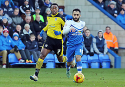 Peterborough United's Erhun Oztumer gets away from Colchester United's Sanchez Watt  - Photo mandatory by-line: Joe Dent/JMP - Mobile: 07966 386802 - 10/01/2015 - SPORT - Football - Peterborough - ABAX Stadium - Peterborough United v Colchester United - Sky Bet League One