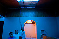 Juan P. Rodriguez Acevedo and his children survey their home, now covered by a set of tarps, after Hurricane Maria ripped the roof away six weeks before destroying nearly all of the family's possessions, in Vegas Arriba, in the municipality of Adjuntas, Puerto Rico.