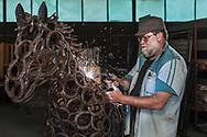 Pieter Heunis welding one of his horse sculptures in his workshop in Robertson.