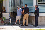 Vincent Yonai is handcuffed by Mifflinburg Police during the Mifflinburg Pride Event. Yonai used yellow caution tape to block access to the sidewalk near his house on Chestnut Street. When a pedestrian used the sidewalk Yonai went after him with a metal bat.