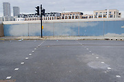 An empty urban landscape of a pedestrian crossing that leads nowhere in Stratford during the second wave of the Coronavirus pandemic, on 26th November 2020, in London, England. Stratford was the home of the London 2012 Olympics where industrial estates centred around Carpenters Road were demolished to make way for sports venues  and now, after 8 years, for extensive housing. In the week of 8th-14th November, the east London borough of Newham (including Stratford) reported 703 positive cases (an increase of 13 from the previous 7 days) with a total of 6,259 cases.