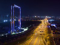 Aerial view of empty streets and a building at night due to the coronavirus pandemic in Dubai, United Arab Emirates
