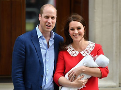 File photo dated 23/04/18 of the Duke and Duchess of Cambridge leaving the St Mary's Hospital, London with their newborn son Prince Louis of Cambridge, who will be christened in front of close members of the royal family on Monday.