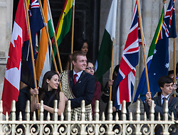 Westminster Abbey, London, March 14th 2016.  Her Majesty The Queen, Head of the Commonwealth, accompanied by The Duke of Edinburgh, The Duke and Duchess of Cambridge and Prince Harry attend the Commonwealth Service at Westminster Abbey on Commonwealth Day. PICTURED: Commonwealth flag bearers emerge from the Abbey at the end of the service.