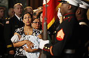 Chicago police Officer Christina Rodriguez (cq) holds her 5-week-old son Alejandro Valadez, Jr. (cq) during the Sheriff's Law Enforcement Awards Ceremony at the Chicago Cultural Center on Wednesday, Oct. 14, 2009. Rodriguez's fiance, Chicago police Officer Alejandro Valadez (cq) was honored with the Award of Valor for Heroism and Bravery after being killed in the line of duty. (Brian Cassella/Chicago Tribune)