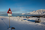 "Polar Bear Warning Sign on the outskirts of Longyearbyen, on the Arctic island of Spitsbergen, in Svalbard. There's more polar bears than people in the region, and it is dangerous to stray beyond the town limits without a gun, and knowing how to use it. The sign reads ""Gjelder hele Svalbard"": ""the entire Svalbard""."