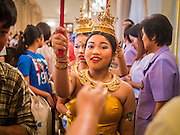 10 JANUARY 2015 - BANGKOK, THAILAND: Thai teenagers dressed as traditional dancers walk through the auditorium during Children's Day festivities at Government House in Bangkok. National Children's Day falls on the second Saturday of the year. Thai government agencies sponsor child friendly events and the military usually opens army bases to children, who come to play on tanks and artillery pieces. This year Thai Prime Minister General Prayuth Chan-ocha, hosted several events at Government House, the Prime Minister's office.    PHOTO BY JACK KURTZ