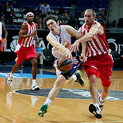 Anadolu Efes's Cedi Osman (L) and Olympiacos's Matt Lojeski (R) during their Gloria Cup Basketball Tournament match Anadolu Efes between Olympiacos at Ulker Sports Arena in istanbul Turkey on Tuesday 23 September 2014. Photo by Aykut AKICI/TURKPIX