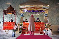 Worshipping at the Sikh Temple on Guru Nanaks Birthday,