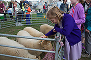 People gathering to hang out, listen to bands and other activities at the Blue Ribbon Village. Kids interracting with farmyard animals. Totally Thames takes place over the whole month in September, combining arts, cultural and river events presented by Thames Festival Trust throughout the 42-mile stretch of the River Thames in London, UK.