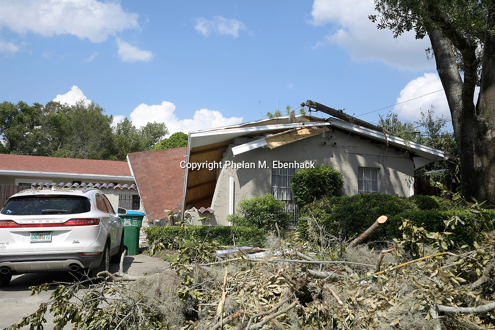 A home sits damaged from a tree blown down during Hurricane Irma Thursday, Sept. 14, 2017, in Maitland, Fla. (Photo by Phelan M. Ebenhack)