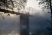 Morning fog envelopes a closed bridge across the Illinois River just east of Tahlequah, OK.