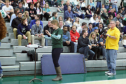 21 February 2015:  Photographer Jeff Findley photographs the pep band from behind the conductor during an NCAA women's division 3 CCIW basketball game between the Elmhurst Bluejays and the Illinois Wesleyan Titans in Shirk Center, Bloomington IL