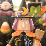 Ceramic statues of a witch and other humorous halloween figures