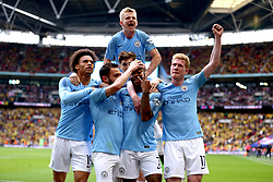 Manchester City's Raheem Sterling (centre, bottom row) celebrates scoring his side's fifth goal of the game with his team mates