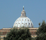 The dome of St. Peter's Basilica in the Vatican City, Italy. The church is the most renowned work of Renaissance architecture, and was designed by Donato Bramante, Michelangelo, Carlo Maderno and Gian Lorenzo Bernini. The original basilica is from 4th century AD, but the current design was completed in 1626.