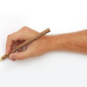 Male hand with red pencil over white background