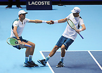Tennis - 2017 Nitto ATP Finals  at The 02 - Day Two, Monday<br /> <br /> Jamie Murray and Bruno Soares v Bob Bryan and Mike Bryan (USA)<br /> <br /> Bob Bryan and Mike Bryan help each other on their way to victory <br /> <br /> COLORSPORT/ANDREW COWIE