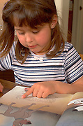 Preschooler age 5 reading picture book.  WesternSprings  Illinois USA