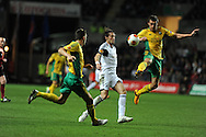 Swansea city's Michu goes past Artem Fidler ®.UEFA Europa league match, Swansea city v FC Kuban Krasnodar at the Liberty Stadium in Swansea, South Wales on Thursday 24th October 2013. pic by Andrew Orchard, Andrew Orchard sports photography,