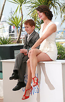 Abdul-Khalim Mamatsuiev and Bérénice Bejo at the photo call for the film The Search at the 67th Cannes Film Festival, Wednesday 21st  May 2014, Cannes, France.