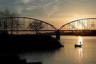 fishing on the Arkansas River by a old railroad bridge near downtown Little Rock Arkansas and the President Clinton Library