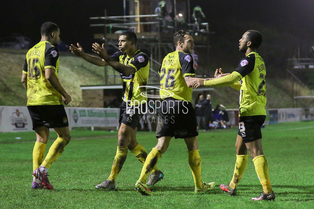 Dagenham players celebrate Kyle Vassell's goal during the The FA Cup 2nd round replay match between Whitehawk FC and Dagenham and Redbridge at The Enclosed Ground, Whitehawk, Brighton, United Kingdom on 16 December 2015. Photo by Ellie Hoad.