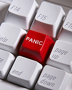 "Close up of a computer keyboard with a red ""PANIC"" key"