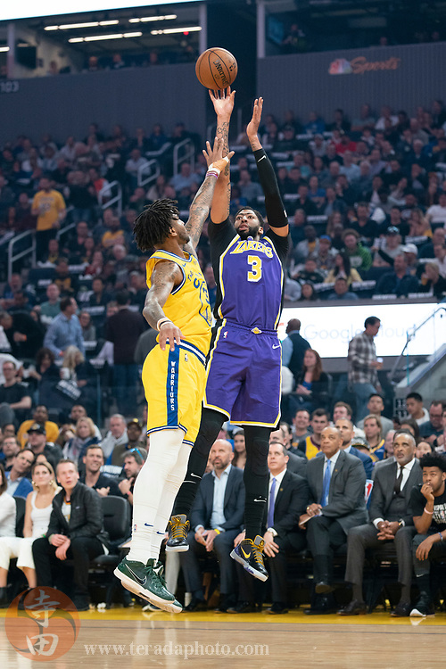 February 27, 2020; San Francisco, California, USA; Los Angeles Lakers forward Anthony Davis (3) shoots the basketball against Golden State Warriors center Marquese Chriss (32) during the first quarter at Chase Center.
