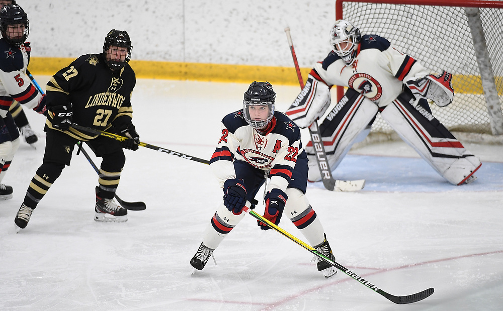PITTSBURGH, PA - DECEMBER 03: Emilie Harley #22 of Robert Morris Colonials defends in front of Raygan Kirk #1 in the third period during the game against the Lindenwood Lions at Clearview Arena on December 3, 2020 in Pittsburgh, Pennsylvania. (Photo by Justin Berl/Robert Morris Athletics)