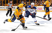 NASHVILLE, TN - MAY 02:  Paul Stastny #26 of the St. Louis Blues watches as Viktor Arvidsson #38 of the Nashville Predators fires a shot during the first period of Game Four of the Western Conference Second Round during the 2017 NHL Stanley Cup Playoffs at Bridgestone Arena on May 2, 2017 in Nashville, Tennessee.  (Photo by Frederick Breedon/Getty Images)